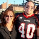 "Frostburg State University football player Derek Sheely with his mother, Kristen (right), who says, ""We're haunted with the terrible unreality all the time."" (Photograph provided by the Sheely family)"