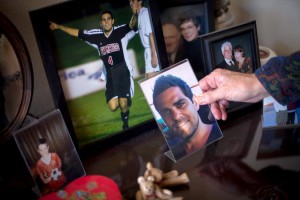 Photographs of Patrick Grange, who had chronic traumatic encephalopathy and died of amyotrophic lateral sclerosis at 29, at his parents' home in Albuquerque. Credit Mark Holm for The New York Times