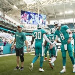 Miami Dolphins quarterbacks Ryan Tannehill (left) and Matt Moore (8) welcome the team onto the field before the start of the game at Hard Rock Stadium in Miami Gardens, Florida, Jan. 1, 2017. Miami Dolphins quarterbacks Ryan Tannehill (left) and Matt Moore (8) welcome the team onto the field before the start of the game at Hard Rock Stadium in Miami Gardens, Florida, Jan. 1, 2017. Bryan Cereijo